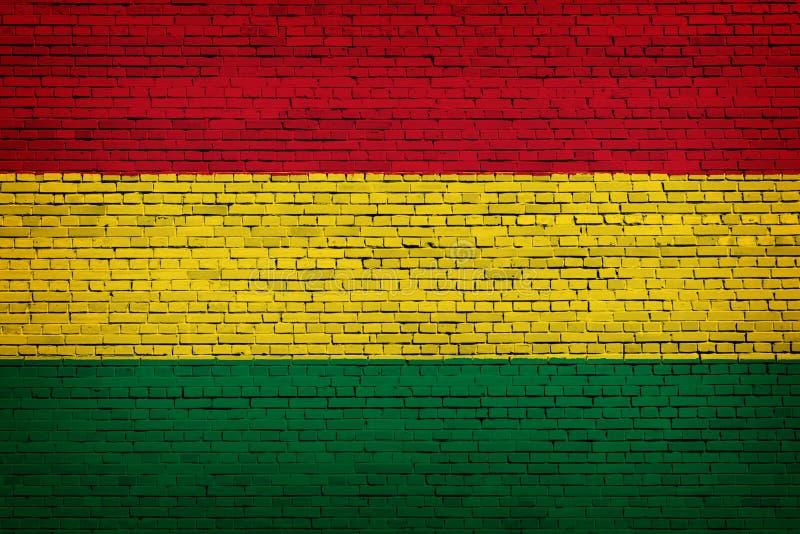 Staatsflagge von Bolivien auf einem Ziegelstein stock abbildung