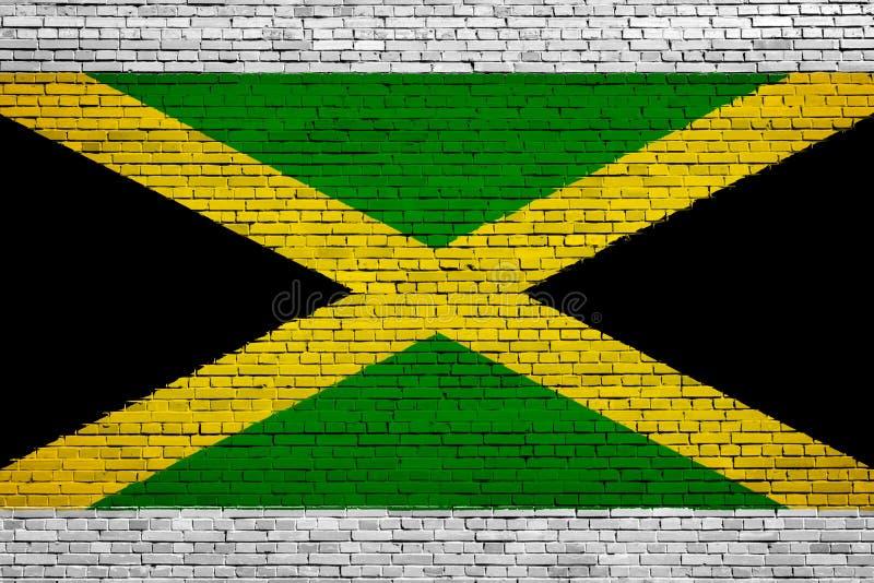 Staatsflagge von Jamaika auf einem Ziegelstein lizenzfreie abbildung