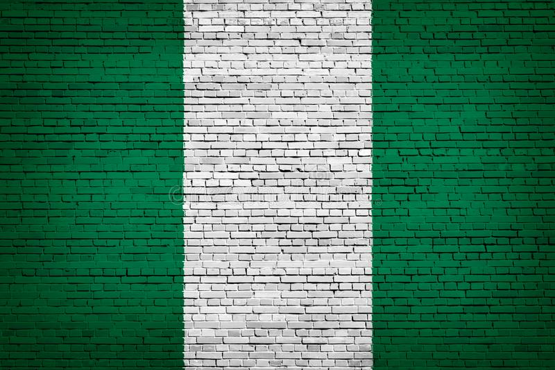 Staatsflagge von Nigeria auf einem Ziegelstein lizenzfreie abbildung