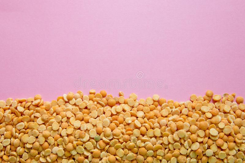 Stab peas on pink background with copy space at the top for lettering.  stock photography