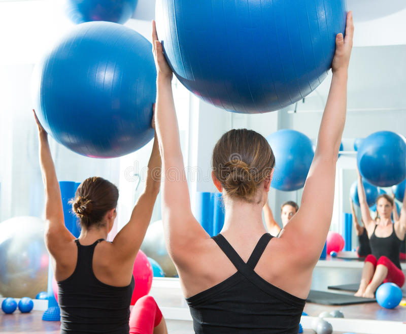 Stability ball in women Pilates class rear view royalty free stock photography