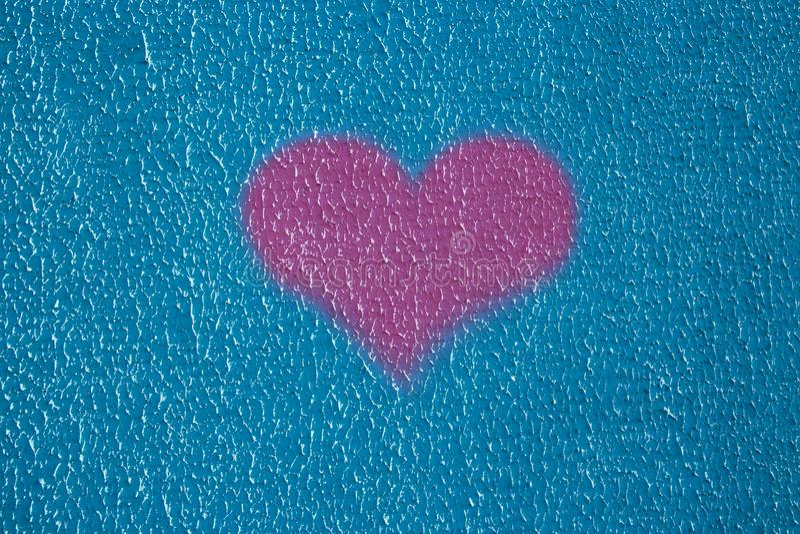 Stachelnicht gleicher blauer Kitt des Hintergrundbeschaffenheits-Wandputzes außerhalb des Herzliebesrosas lizenzfreie stockfotografie