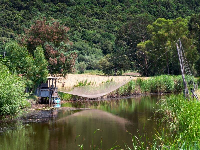 Stacjonarny dźwignięcie zarabia netto dla łowić w rzece blisko Pisa, Włochy zdjęcia royalty free