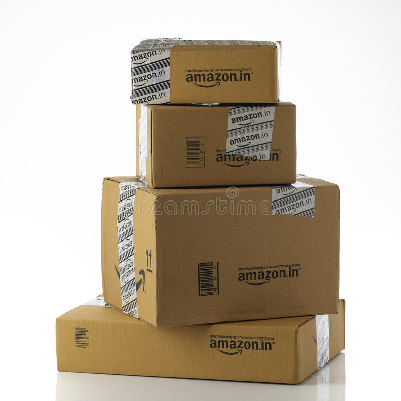 Stack of Amazon.in Packages on White Background stock photo