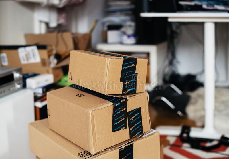 Stack of Amazon Prime cardboard box one above another in room stock photo