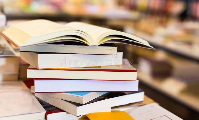 Stack of books lying on table in bookstore. Stack of art books lying on table in bookstore royalty free stock image
