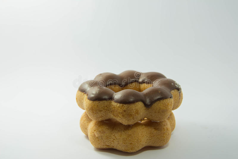 Stack of assorted donuts on a white stock images