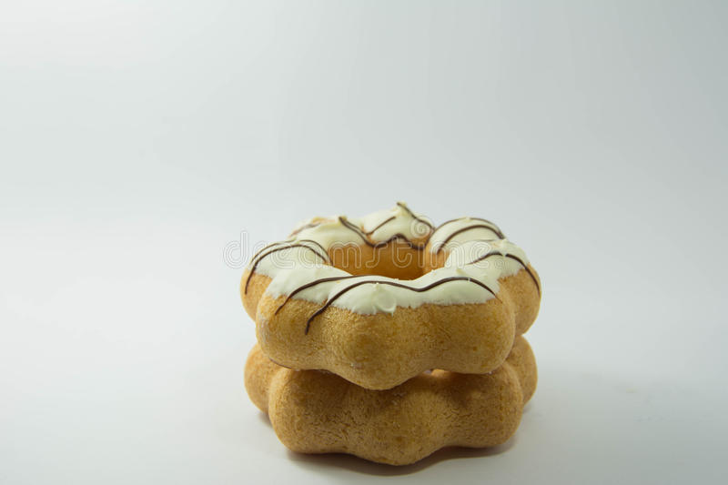 Stack of assorted donuts on a white royalty free stock photo