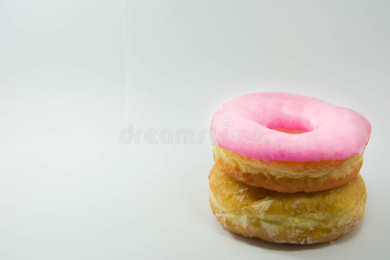 Stack of assorted donuts on a white plate on pastel royalty free stock photo