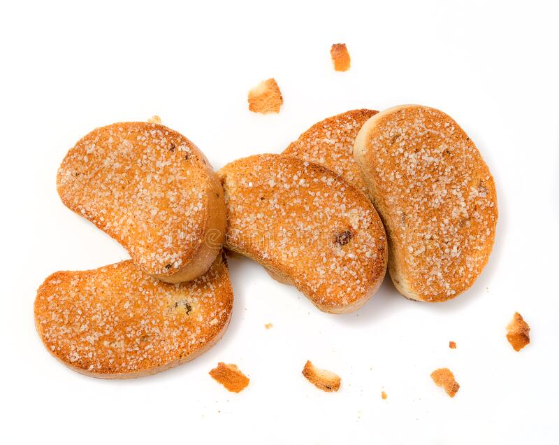 Stack av zwieback sprinklad med socker arkivbild