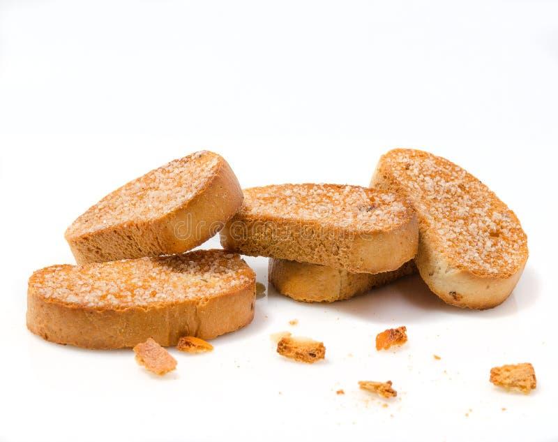 Stack av zwieback sprinklad med socker arkivbilder