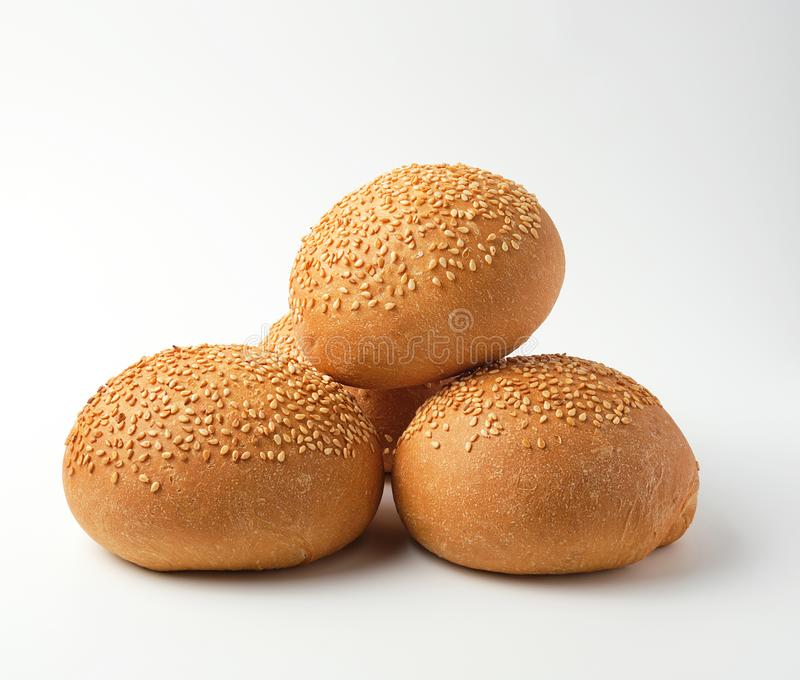 stack of baked whole round bun with sesame seeds made from white wheat flour stock image