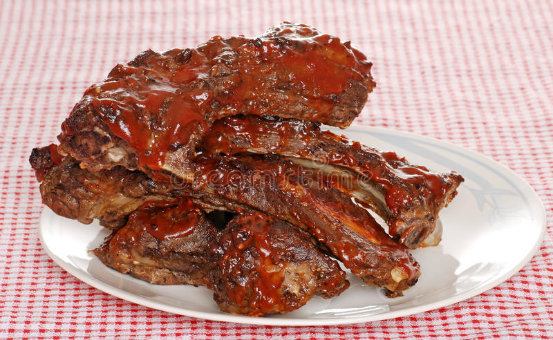 Stack of barbecue beef spare ribs with sauce royalty free stock photo