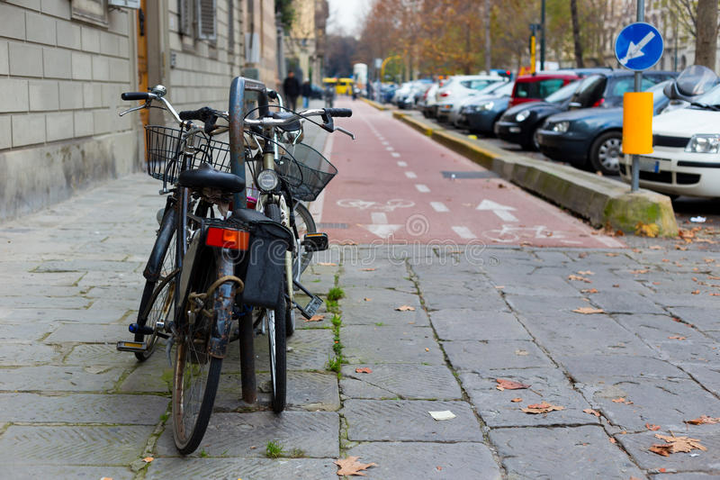Stack of bicycles parked near the bike lane stock image