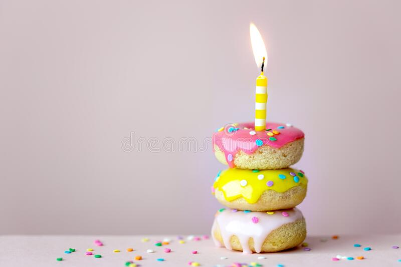 Stack of birthday donuts stock photo