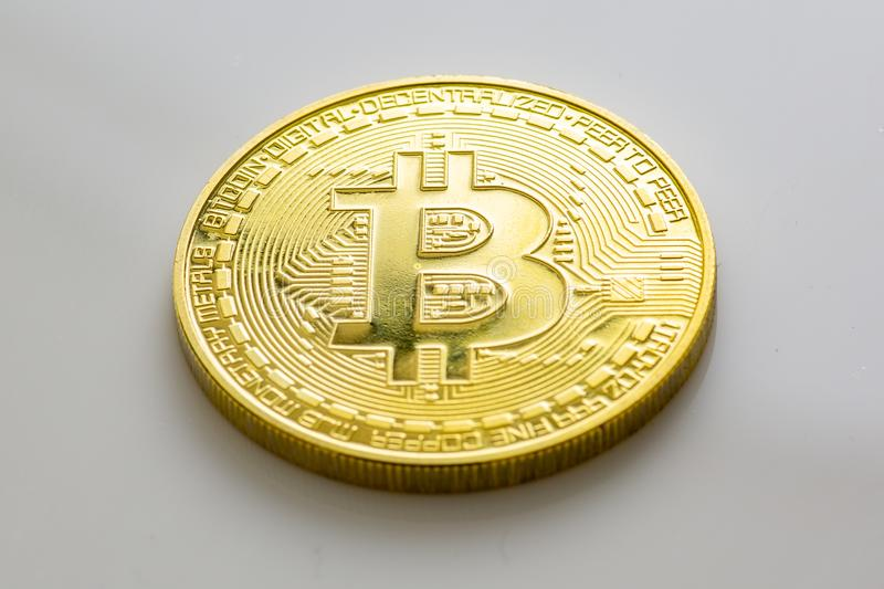 Stack of bitcoins and other crypto currencies on a white table stock photo