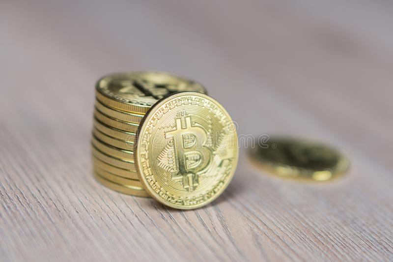 Stack of bitcoins with a single coin facing the camera in sharp focus stock image