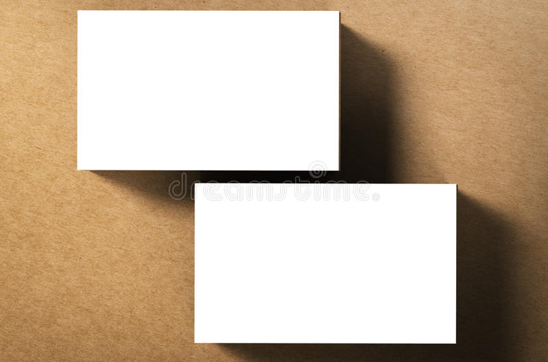 Stack of blank name cards. On brown background stock image