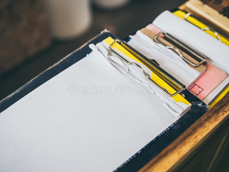 Stack of blank notepad torn in the clipboard for note order list in a coffee shop or restaurant stock images
