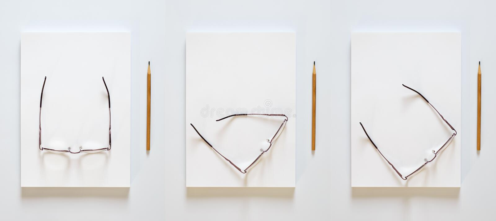 A stack of blank sheets of paper. Pencil and glasses in different positions on a white background stock photos