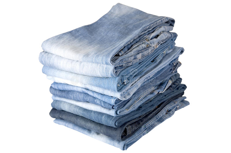 Stack of blue denim jeans royalty free stock images