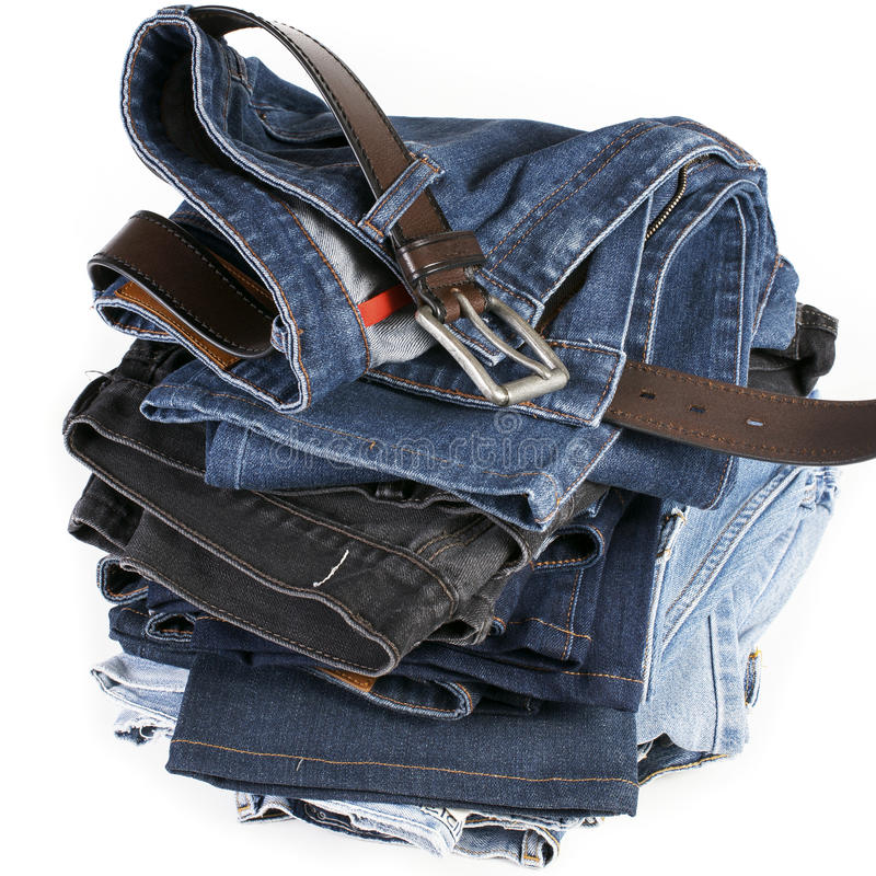 Download Stack Of Blue Jeans With Brown Belts Stock Photo - Image: 26375788
