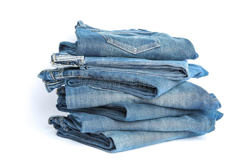 Stack of blue jeans on white background royalty free stock photos