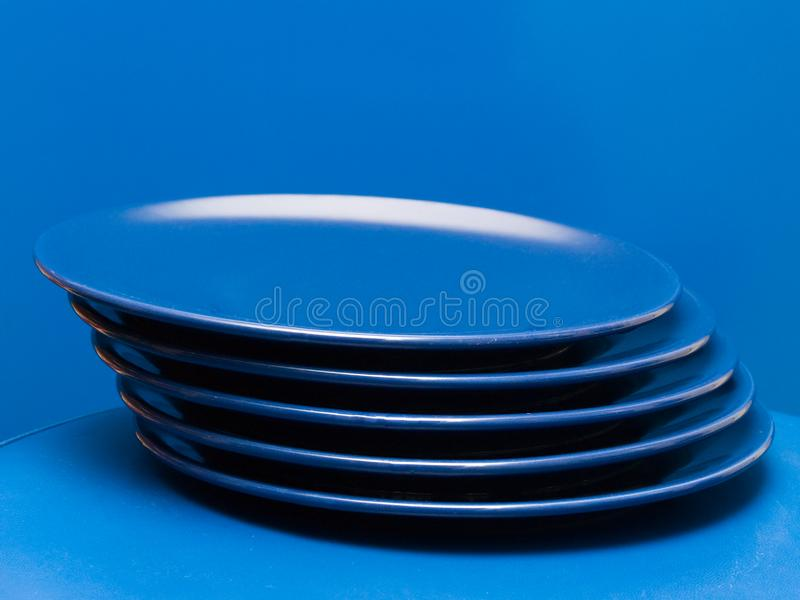 Download Stack of blue plates 2 stock photo. Image of plate, serving - 8639106