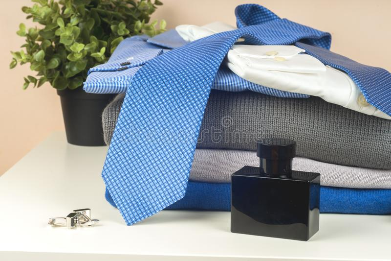 Stack of blue and white shirt closeup on a light background. stock photos
