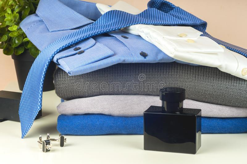 Stack of blue and white shirt closeup on a light background. stock image