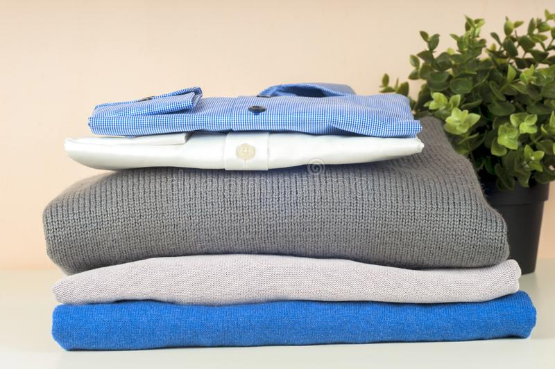 Stack of blue and white shirt closeup on a light background. royalty free stock image