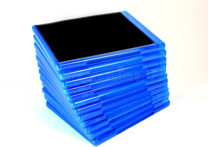 Stack of Bluray disk boxes. Pile of Blu Ray disc cases on white background royalty free stock images