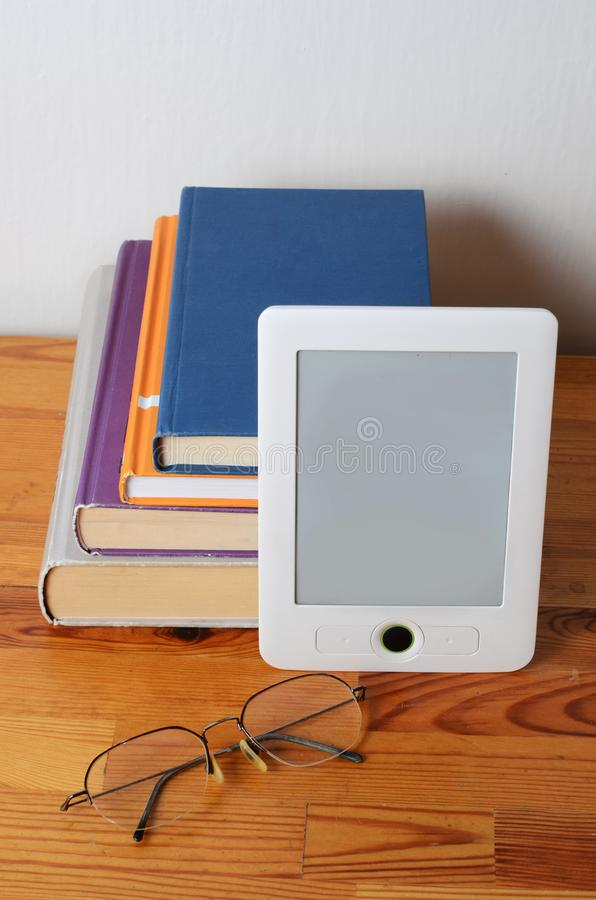 Stack of book and ebook reader royalty free stock photos