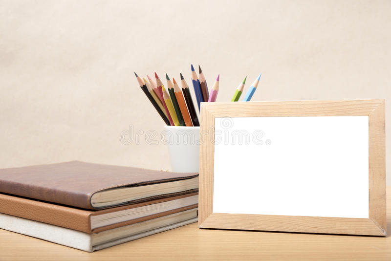 Stack of book and photo frame with color pencil royalty free stock images