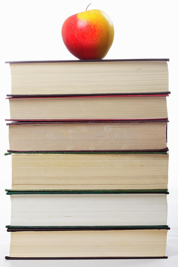 Stack of books with apple on top royalty free stock photo