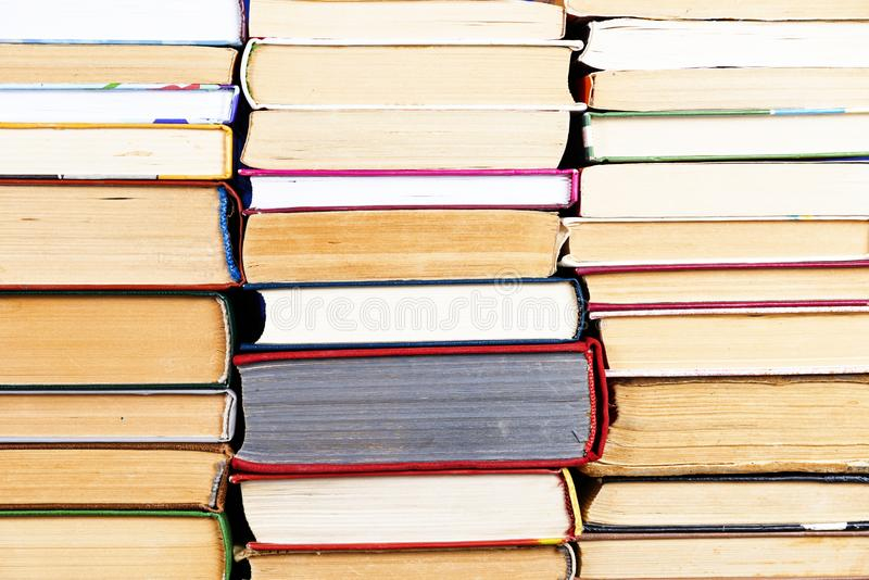 Stack of books background. many books piles.  stock photos