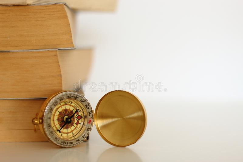 Stack of books and compass. royalty free stock photography