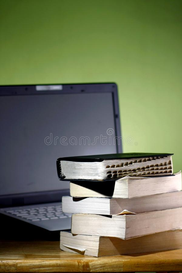 Stack of books and a Computer laptop stock photos