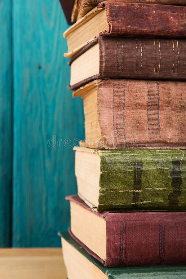 stack of books on the desk over wooden background royalty free stock photo