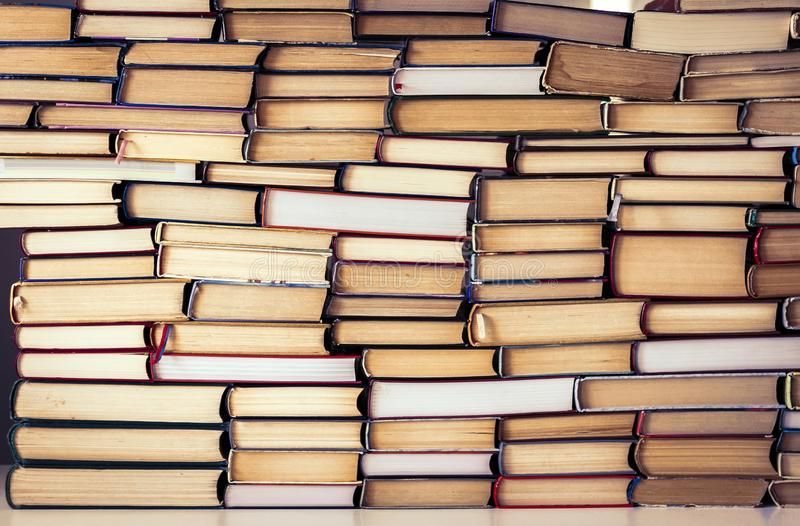 Stack of books education concept background, many books piles stock photo
