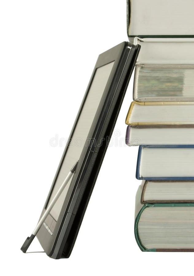 Stack of books and electronic book reader. On the white background stock image