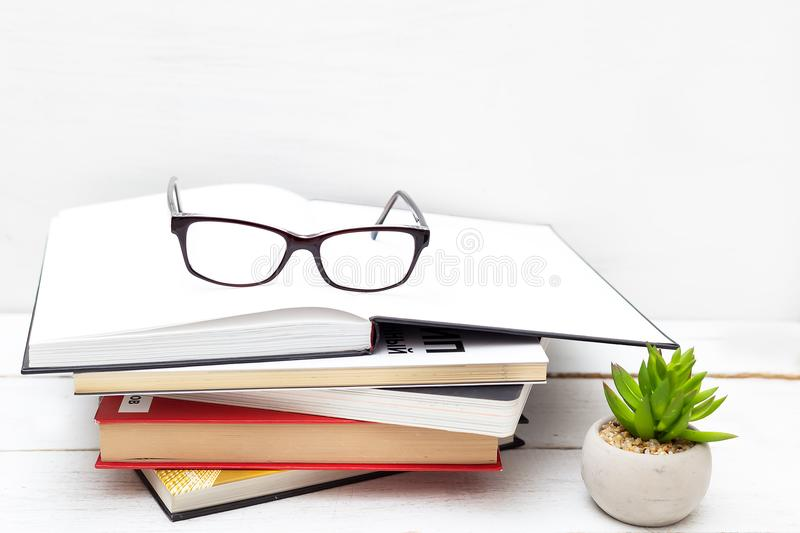 Stack of books and glasses on a white background royalty free stock images