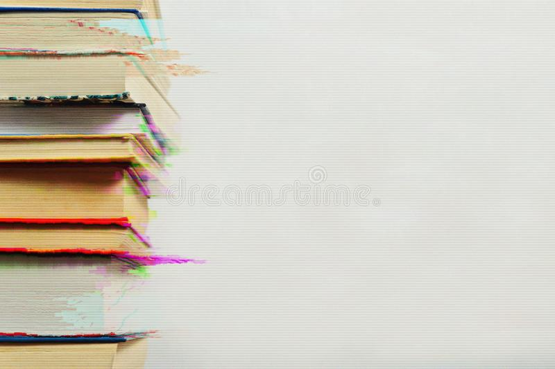 Stack of books in the glitch effect royalty free stock photos