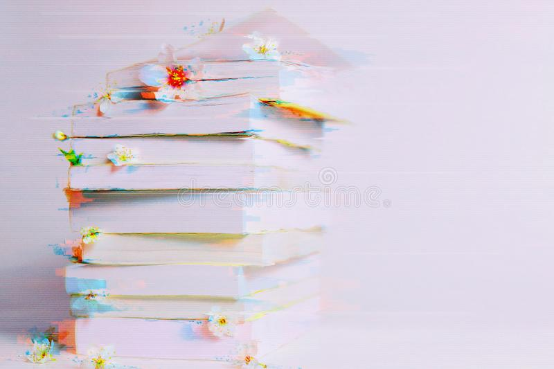 Stack of books in the glitch effect stock image