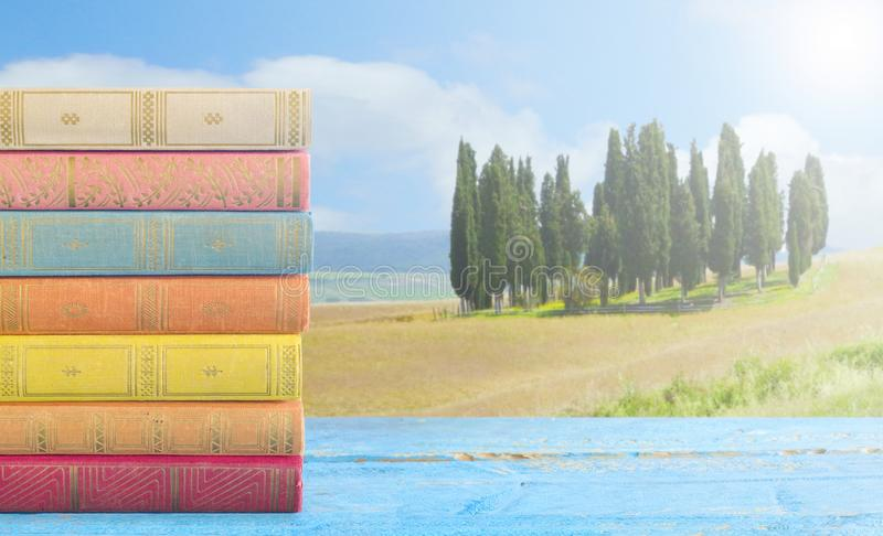 Stack of books and italian landscape, relaxing and re. Stack of books and italian landscape relaxing and reading during vacation stock image