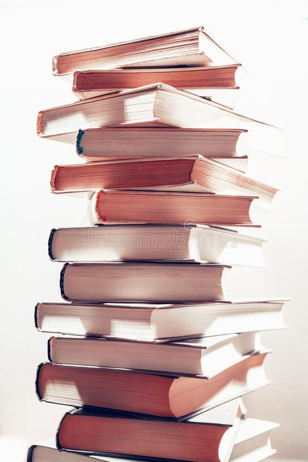 Stack of books in library. Scientific, educational, and fiction paper books. Education and training stock photos