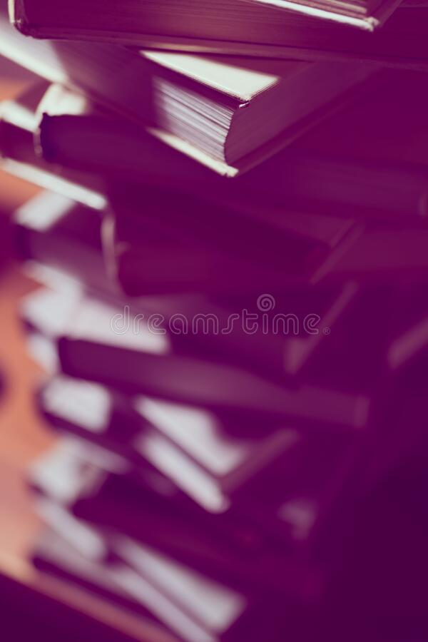 Stack of books in library. Scientific, educational, and fiction paper books. Education and training stock image