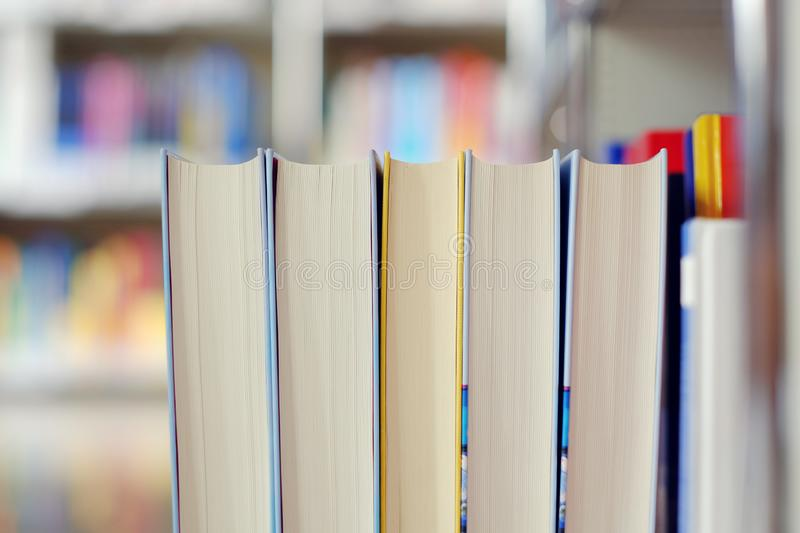 Stack of books in a library. Stack of books on a shelf in a library, read, white, education, study, school, learn, yellow, information, colledge, degree, student royalty free stock photos