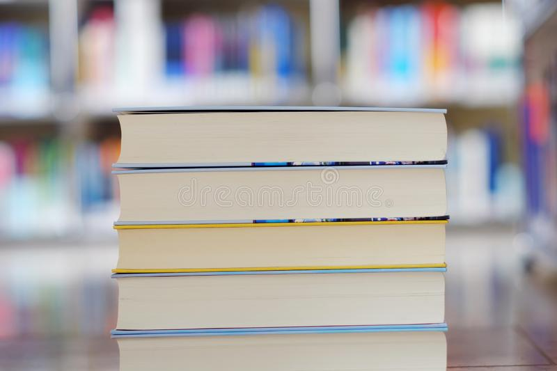 Stack of books in a library. Stack of books on a shelf in a library, read, white, education, study, school, learn, yellow, information, colledge, degree, student stock image