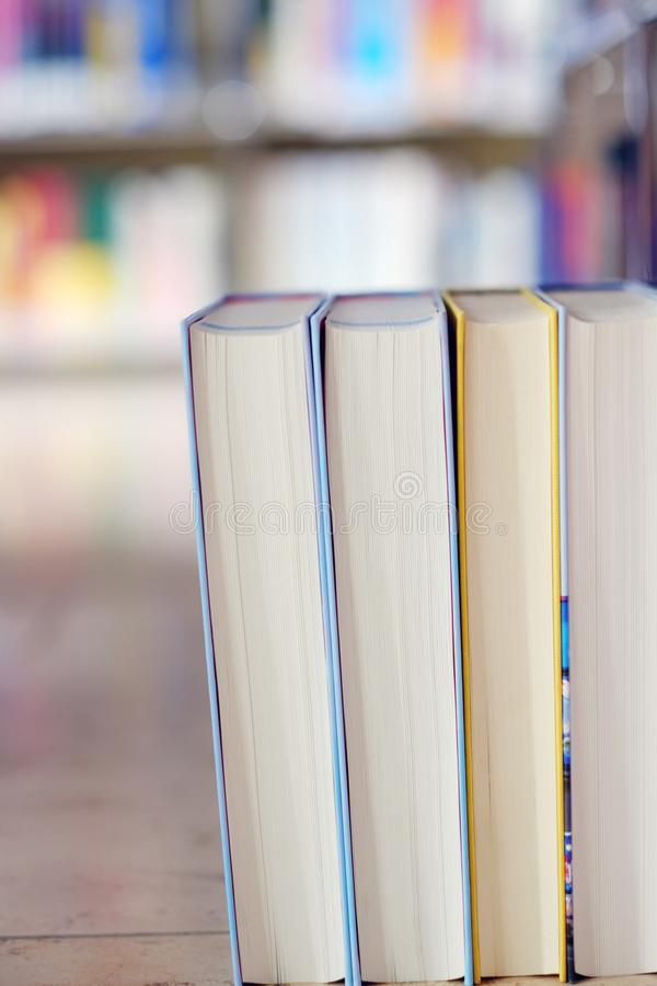Stack of books in a library. Stack of books on a shelf in a table, library, read, white, education, study, school, learn, yellow, information, colledge, degree royalty free stock photos